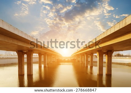 Highway and viaduct under the blue sky - stock photo