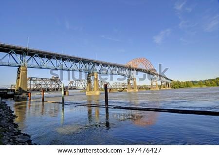 highway bridge and railroad bridge - stock photo