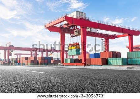 Highway bridge and truck transport container on the road to the port. - stock photo