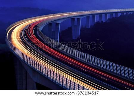 Highway bridge at night - stock photo
