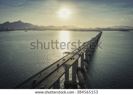 Highway Bridge over the ocean leading to the city, Rio de Janeiro, Brazil - stock photo