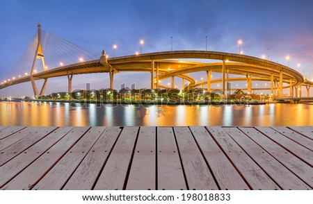 Highway bridge with street light reflect in water at night. - stock photo