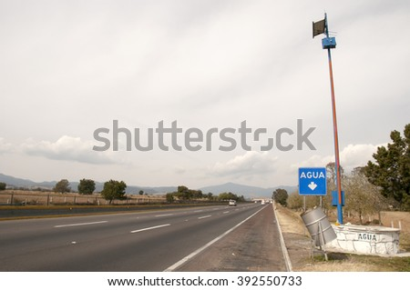 Highway 150 D  from Puebla to Mexico city,with a sign for water stop - stock photo