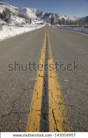 Highway 33 heads up the mountain after a fresh snowfall north of Ojai, California - stock photo