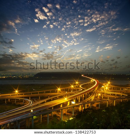 Highway in night with cars light in modern city in Taiwan, Asia.  - stock photo