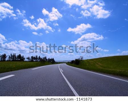 Highway in to the horizon of summer landscape, jutland, denmark - stock photo