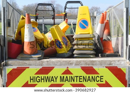 Highway maintenance truck with signs - stock photo