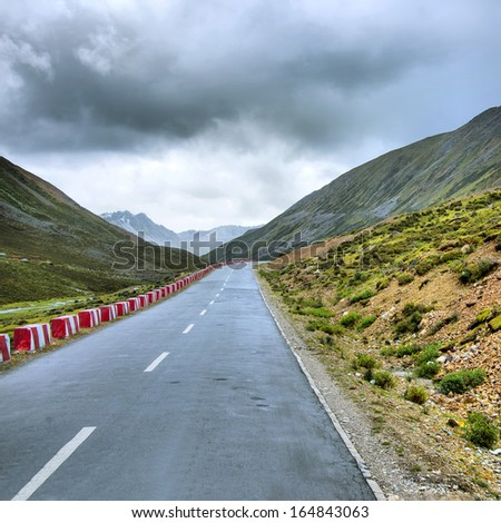 Highway Mountains in Tibet (automotive advertising background) - stock photo