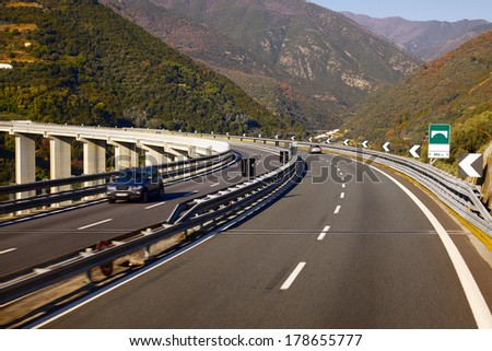 Highway over a viaduct with little traffic - stock photo