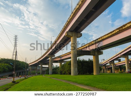 Highway over green meadow in Taipei - stock photo