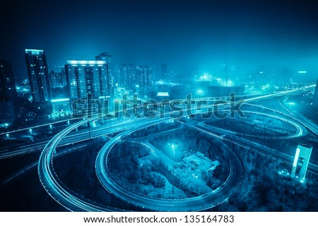 highway overpass at night in xian,China - stock photo
