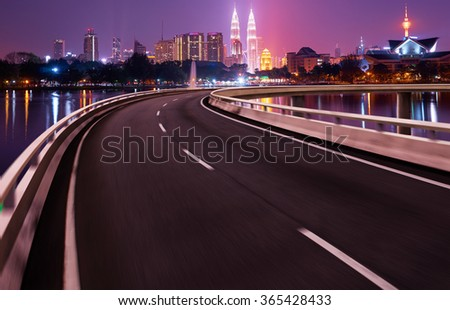 Highway overpass motion blur with city background .night scene - stock photo