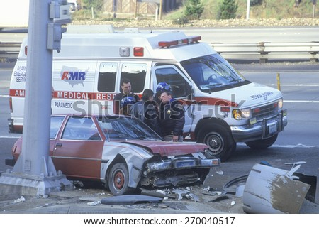 Highway patrolman at automobile accident, California - stock photo