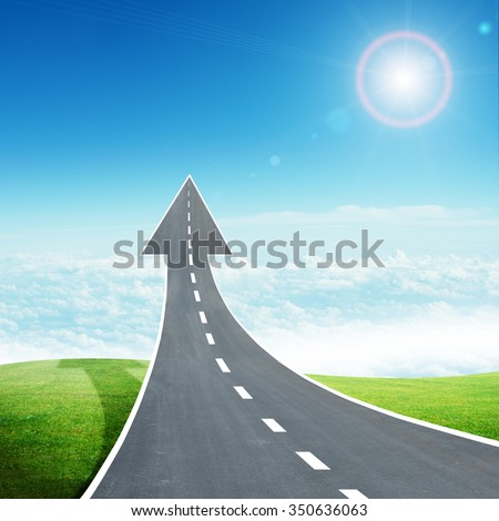 Highway road going up as an arrow in sky - stock photo