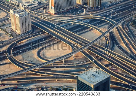 Highway road intersection in Dubai, UAE in the evening. Downtown Burj Dubai. - stock photo