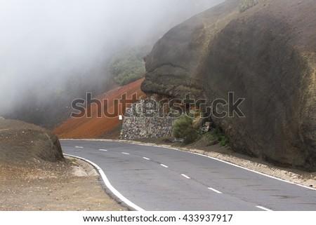 Highway road line in Timanfaya, Lanzarote. Spain. Road to volcano - stock photo