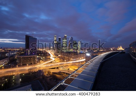 Highway, roof at night and modern skyscrapers in Moscow, Russia, long exposure - stock photo