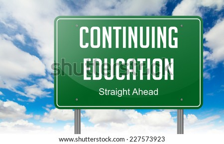 Highway Signpost with Continuing Education wording on Sky Background. - stock photo