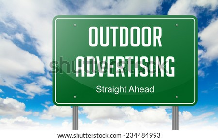 Highway Signpost with  Outdoor Advertising Wording on Sky Background. - stock photo
