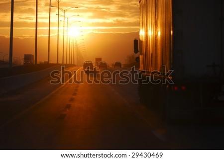 Highway sunset - stock photo