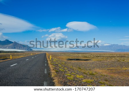 Highway through Iceland landscape sunny day. Horizontal shot - stock photo