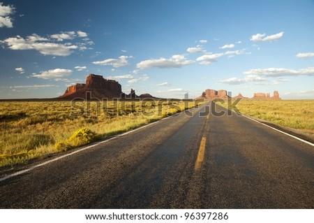 Highway 163 through Monument Valley at sunset, Arizona, Utah, Navajo Nation, USA - stock photo