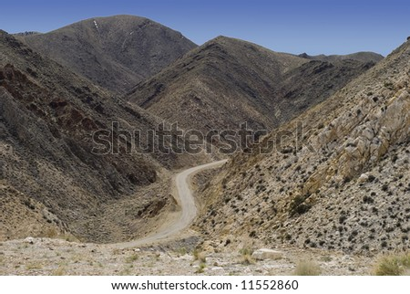 Highway Through The Death Valley Hills California - stock photo