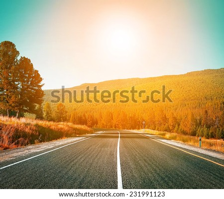 highway to sunset (filtered) - stock photo