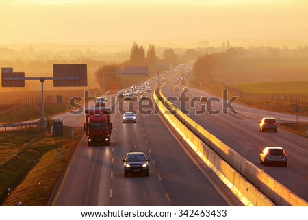 Highway Traffic at Sunset. - stock photo