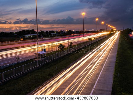 Highway traffic at the evening. Cars lights in motion on the streets. Transport, transportation industry - stock photo