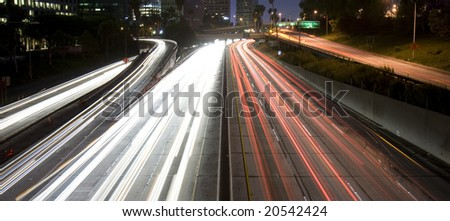 Highway traffic in Los Angeles (time lapse with traffic as trails of light) - stock photo