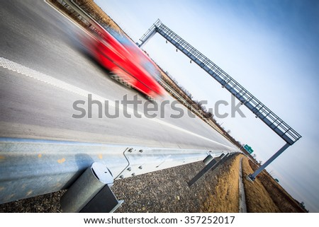 Highway traffic - motion blurred cars on a highway - stock photo