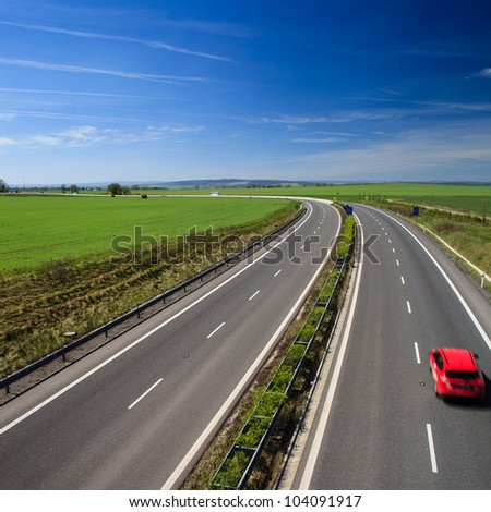 highway traffic on a lovely, sunny summer day - stock photo
