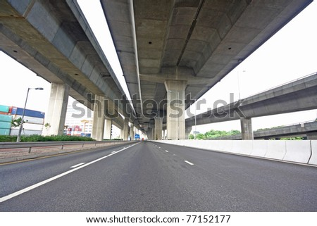 highway under the bridge - stock photo