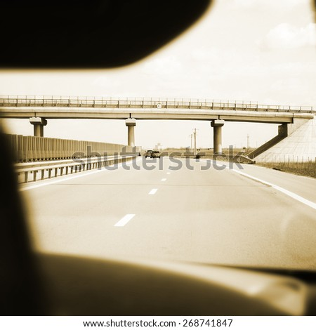 Highway viewed from car interior. - stock photo