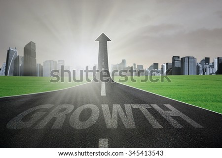 Highway with a Growth text turning into arrow upward, symbolizing business growth - stock photo