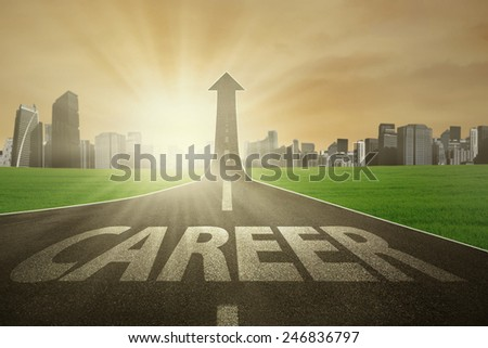 Highway with career text rising upward with sunrise in the morning, symbolizing the way to the bright career - stock photo