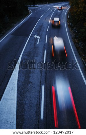 Highway with cars motion blur at dusk - stock photo