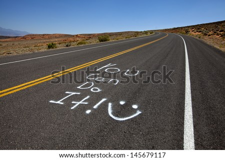 """Highway with encouraging message saying """"you can do it!"""" - stock photo"""