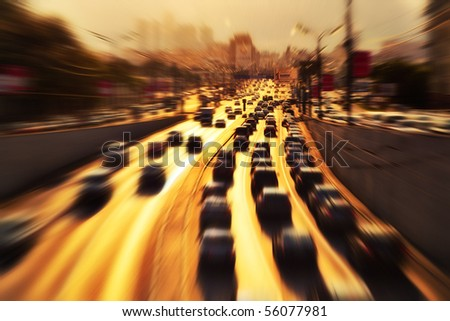 Highway with lots of cars. Zoom blur effect. - stock photo
