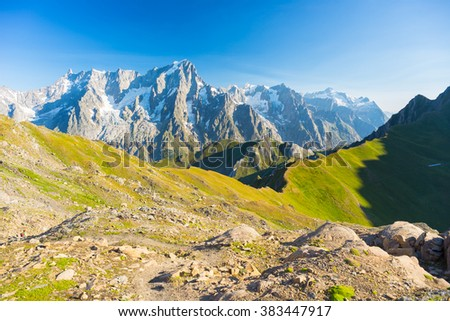 Hih mountain trail with great panoramic view over the Mont Blanc massif. Backpacker's summer adventures and wanderlust in Valle d'Aosta, Italian French Alps. - stock photo