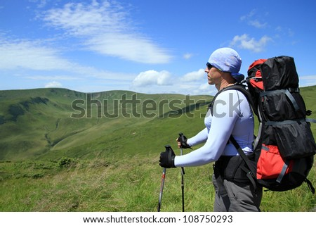 Hike in the mountains during the summer. - stock photo