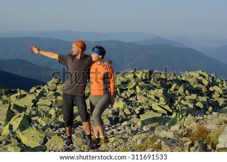 Hike in the Ukrainian Carpathians. Family on a mountain top - stock photo