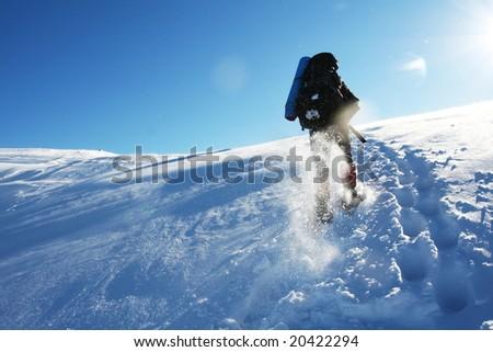 Hike in winter mountain - stock photo