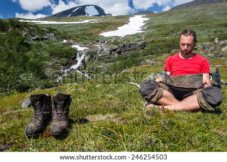 Hiker and Boots take a break - stock photo