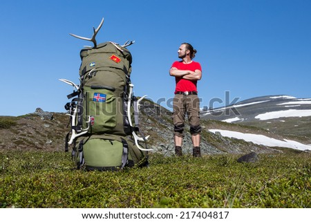 Hiker and huge backpack - stock photo