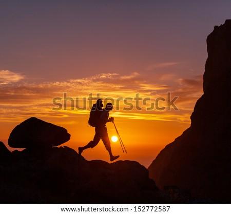 hiker at sunset - stock photo