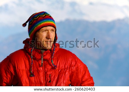 hiker at the top of a pass meeting the sunrise in the mountains - stock photo