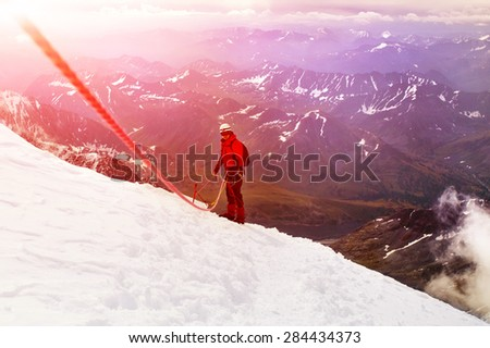 hiker at the top of a pass with backpack enjoy sunny day in Himalayas, Nepal. - stock photo