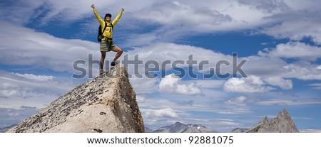 Hiker  celebrates on the summit. - stock photo